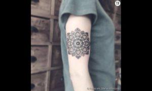 Tatouage mandala bras haut du bras